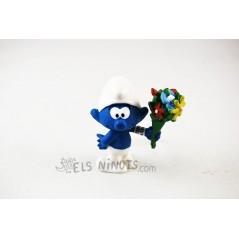 Figura Pitufo con ramo de flores